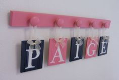 Baby Nursery Decorating Ideas and Gifts, Set Includes 5 Hooks and Babies Name PAIGE - Pink and Navy Baby Girls Room Wall Decor. $29.00, via Etsy.