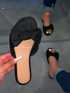 SIZE Heel Height Approx: True to size Model wears a size and is wearing a size in this sandal. DETAILS Suede Straps with Bow Detailing Slip-On Entry Black Bow Sandal Trendy Sandals, Cute Sandals, Black Sandals, Shoes Sandals, Flats, Fashion Slippers, Fashion Sandals, Cute Slippers, Aesthetic Shoes