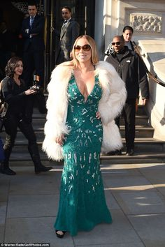 Here she is! Renowned pop diva Mariah Carey cemented her superstar status once more as she made a glamorous exit from London's Corinthia Hotel on Thursday afternoon