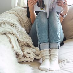 Snuggly socks with a magazine