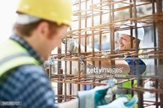 Stock Photo : Constructor workers assembling rebar structure at construction site