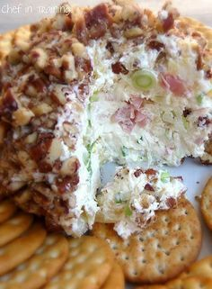 PINEAPPLE CHEESE BALL: 1-1/2 packages (12 oz) cream cheese, 1 small can crushed pineapple (well drained), powdered sugar (to taste- approximately 2-3 Tbsp.), green onion (optional-to taste, approximately 2 Tbsp.), chopped ham (optional-to taste, approximately 2-3 Tbsp., chopped pecans (about 1 cup worth) -- Directions: 1) Combine all ingredients together. 2) Mash into a ball and chill. 3) Roll in crushed pecans. 4) Refrigerate until served. 5) Serve with crackers.