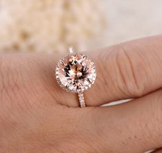 This engagement ring set was designed by Camellia Jewelry. This diamond engagement Ring is set with a round cut natural diamond set on the top of camellia flower . To achieve this stunning look, Weve created a matching diamond wedding band set in Alexandrite Engagement Ring, Morganite Engagement, Morganite Ring, Halo Diamond Engagement Ring, Diamond Wedding Bands, Wedding Rings, Diamond Rings, Gold Ring, Gold Wedding