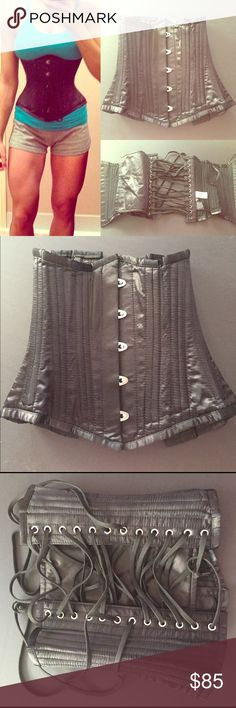 Black metal ribbed corset. Perfect condition. Worn a handful of times over a tank top. It is meant for a 25 waist to singe down. It would fit if you are above a 25 waist but it won't work as well because the back will be held together by strings only. DISCLAIMER: This is not a waist trainer you can wear to the gym. This corset has metal rods, it can restrict breathing. It does a way better job defining the waste but it is not bendable. This corset is REAL. I purchased from a website that…