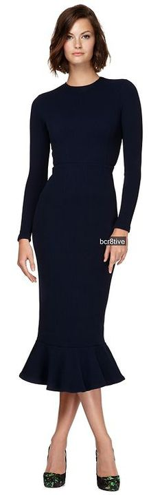 Classic navy blue, long sleeve, ruffle hem dress. Wear any bold jewelry with…
