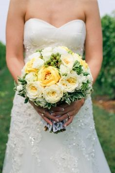 Another great use of yellow but on the more 'subdued pastel side'.  Pairing it with ivory with touches of green give it a 'fresh spring' feel. Bouquet by Elizabeth Anne Designs.
