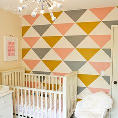 The popular Tri-colors Triangle peel & stick wallpaper will transform your wall and the look of your interior.  Modern geometric wallpaper that