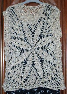 Tunique au crochet fait-main, taille 44-46, tous les détails sur :  http://guyl971.blog4ever.com