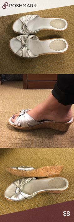BCBG Paris Silver Wedge Sandals These sandals are in very good condition. The cork wedge has silver specs in it.  Tried to show it in picture #3. The size tag peeled off but they are a woman's size 8.  Soles are in perfect condition. BCBG Paris Shoes Sandals