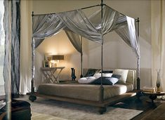Four poster bed all dolled up for a boutique style guest room.