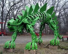 Dinosaur sculpture made from auto parts.  Jim Gary
