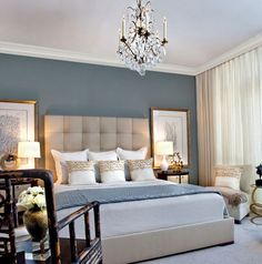 Traquil Blue Seaside Bedroom with upholstered head board, cream pillows with real seashells and pearls! By Nuvo Design Interiors