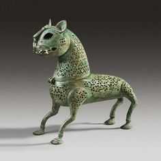 Islamic Bronze Incense Burner Culture : Islamic Period : ca. 11th Century A.D. Phoenix Ancient Art ~ This feline shaped incense burner is covered in an openwork floral pattern.  This high ornamentation was a common aspect of Islamic figures.  Added to gallery on 12/2/13