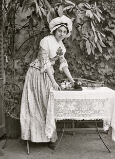 A Maid serving Tea in the Garden c.1897