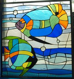 20 1/2 x 21 1/2 stained glass panel of colorful Angel Fish. Price of shipping depends on where this is going. If you are interested in this item let me know where you are and I can give you a price. Sometimes these glass panels need to be double boxed which adds to the size, weight and cost.