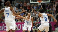 France's Celine Dumerc (C) celebrates her game winning shot against Great Britain during game against France at their women's preliminary round Group B basketball match at the Basketball Arena during the London 2012 Olympic Games August 3, 2012.