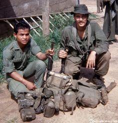 SOG - Spike Team Ohio medic Joe Parnar (right) and team grenadier Mock, a Rhade Montagnard, after returning from a mission. Photo taken: Summer 1968, Kontum (CCC)