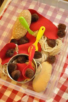 Yarn spaghetti, felt sauce, pom-pom meat balls. Sensory bin idea.