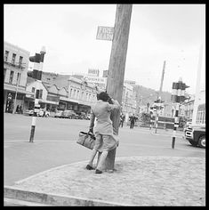 that wind on COURTENAY Place - 1959 - a woman sheltering behind a pole - check out the policeman looks like he's about to come over and help her. Windy Weather, Windy Day, New Zealand Landscape, Weather Alerts, Kiwiana, British Isles, Street View, History, Places