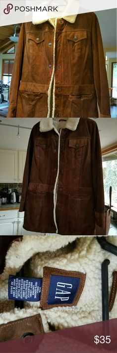 Mid length gap leather jacket This coat lays slightly below the hips. It is a rough leather (suede) and super warm. GAP Jackets & Coats