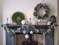 1a3d09bd4d3c Fireplace decorated with Christmas baubles and wreaths Artificial Christmas  Wreaths, Christmas Baubles, Christmas Home