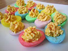 colored deviled eggs...red and blue with yellow yolk and black olive to match party