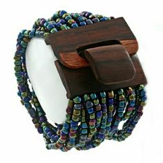 "GWaCJava Bead Cuff Bracelet - Iridescent PLEASE DO NOT PURCHASE THIS LISTING! Individual listings ready for purchase are found in the Multiples Listings section. (5/10/20)  Stretchy to fit most wrist sizes. This is a Balinese artisans only means of income to support her family. Purchasing Lara's necklaces enables her to continue home based work so she can take care of her young children.     Color: Iridescent     Size: 7 1/2 to 9""L x 2""W x 1/2""H     Material: Glass Beads, Mango wood…"