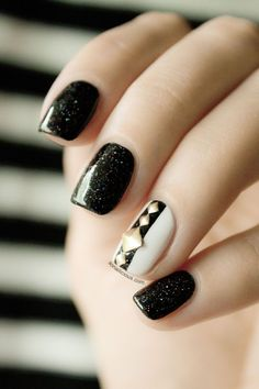 black sparkly nails with one accent