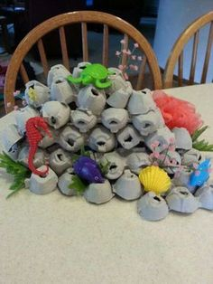 Stunning Under-The-Sea Decorating Ideas Kids Would Love These coral reef made out of egg cartons will look far more realistic, when you add a little bit of paint to them. Under The Sea Theme, Under The Sea Party, Coral Reef Craft, Under The Sea Decorations, Sea Crafts, Ocean Themes, Mermaid Birthday, The Little Mermaid, Crafts For Kids