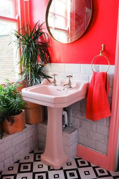 pink bathroom Amys pink and marble bathroom with black and white tiles, green houseplants and brass accents. Green Bathroom Accessories, Red Bathroom Decor, Bathroom Interior, Small Bathroom, Bathroom Black, Bathroom Ideas, Peach Bathroom, Brick Bathroom, Colorful Bathroom