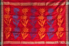 Varied colours of silk threads are used to make floral designs on the saree.