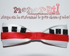 My Disney monorail bow with the option to choose your color stripe to match your favorite monorail! This is my Peter Pan inspired bow, complete with a snazzy feather! http://www.etsy.com/shop/MickeyWaffles?ref=si_shop