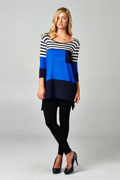 Striking color block top. Fabulous fall top and wardrobe must have.