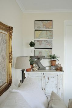 World maps and topiaries master bedroom vignette
