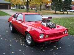 Pro Street Ford Pinto. I went for a ride in a Blown Cleveland powered one when I was a kid. Still scares me thinking about it !!