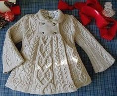Elizabeth CoatThis knit pattern is available as a free download... Download Pattern: Elizabeth Coat