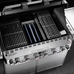 This is one of The Home Depot's best-selling natural gas grills. It's made for serious outdoor cooking. Six stainless-steel burners, a side burner, rotisserie and smoker. Available in black. But, wow, the stainless steel model looks awesome. || Weber Summit E-670 6-Burner Natural Gas Grill