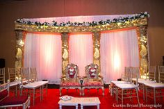 This traditional Indian wedding is a beautiful red and gold event. Wedding Stage, Wedding Reception, Indian Wedding Photos, Traditional Indian Wedding, South Asian Bride, Couples Images, Indian Wedding Decorations, American Wedding, Floral Wedding