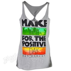 This tank top features Make Way For The Positive Day and Bob Marley printed on the front. There is a green block with palm trees and a red and yellow block with clouds. The tank had a twist razor back, a curved bottom hem and a relaxed fit. Made of 100�0cotton single jersey.