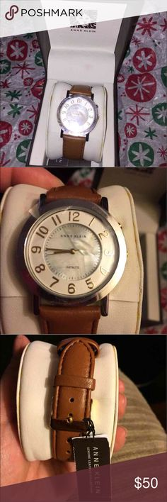 Anne Klein Mother of pearl watch NWT this is a beautiful watch with a great brown leather strap and mother of pearl strap,I never wore this and is beautiful ❤I am putting a new battery in upon purchase.Its lovely so spoil yourself 💜 Anne Klein Accessories Watches