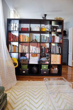 Bookshelf as a room divider- Wallpaper Designer Kimberly Lewis' Brooklyn Alcove