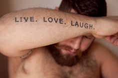 """ live love laugh "" word phrase tattoo writing on the body ginger red hair bear beard mustache arm tattoo"