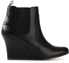 $790, Black Leather Wedge Ankle Boots: Lanvin Wedge Ankle Boots. Sold by farfetch.com. Click for more info: https://lookastic.com/women/shop_items/76418/redirect