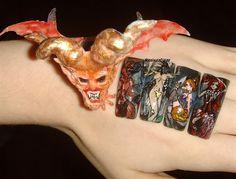 http://nailartgallery.nailsmag.com/mesiaszciszy/photo/339552/hallowen-nail-art-3d-acrylic-evil/user Halloween