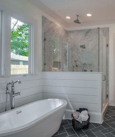 Herringbone slate tile and shiplap walls