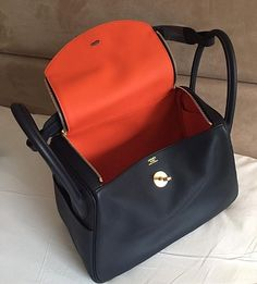Rare Lindy Size 26 for sale at \\\k Blue Indigo exterior with orange poppy interior. Swift Leather Gold hardware Stamp T Bag was bought only in last Hermes Lindy 26, T Bag, Orange Poppy, Hermes Handbags, Suitcases, Travel Bags, Leather Backpack, Poppies, Indigo