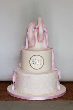 https://flic.kr/p/9ZaBni | 50th Wedding Anniversary... | The husband revolutionized pointe shoes so his children wanted that on the cake.