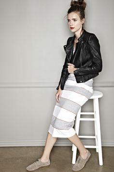 Leather jacket over a striped dress with tennis shoes. Grunge look.