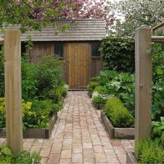 brick paths and wooden raised beds, 4x4 posts