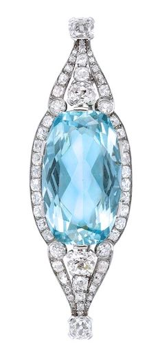 Belle Epoque Platinum, Aquamarine and Diamond Brooch The pierced modified navette-shaped brooch centering one oval aquamarine approximately 27.25 cts., flanked and tipped by 4 cushion and old-mine cut diamonds, set throughout with 52 cushion and old-mine cut diamonds, altogether approximately 4.45 cts., circa 1905, approximately 12.7 dwt.